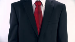 Man In Suit Placing Mobile Phone in Inside Pocket Stock Footage