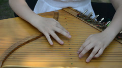 Girl hands play Baltic psaltery string musical instrument Stock Footage
