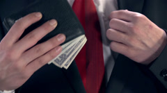 Man In Suit Putting Wallet into Inside Pocket Stock Footage