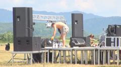 Professional worker man put on equipment speaker multimedia stage metal field  Stock Footage