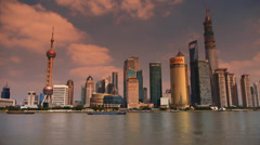 Shanghai timelapse,Lujiazui Economic Center sunset,busy shipping. Stock Footage