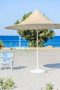 beach umbrellas cyprus - stock photo