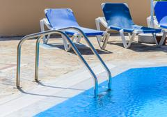Stock Photo of a swimming pool with sun loungers