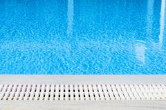 Edge of the swimming pool overflow Stock Photos