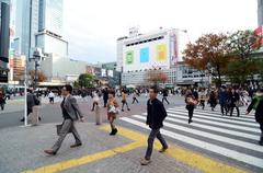 Tokyo - november 28: crowds of people crossing the center of shibuya in novem Stock Photos