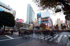 Tokyo - november 28: crowds of people crossing the center of shibuya Stock Photos