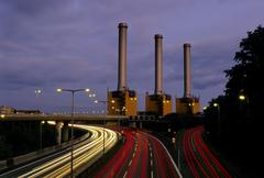 Motorway and Powerstation at night Stock Photos