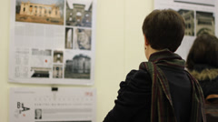Girl Looking at Exposition Stock Footage