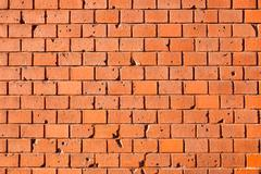Orange brickwall Stock Photos