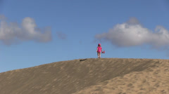 Spain - Gran Canaria - Maspalomas - child is running over a sand dune Stock Footage