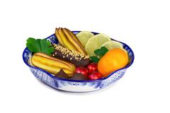 """Cakes, sweets, fruit in a vase, painted in the style of the """"gzhel"""", on a whi Stock Photos"""