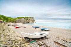 Etretat village, bay beach, aval cliff and boats. normandy, france. Stock Photos