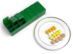 Medication box for the daily ration of a patient Stock Photos
