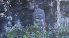 Stone rock carving/sculpture on Rock - Indian Chief - Mabodamaca Stock Footage