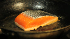 Salmon fillet frying in pan Stock Footage