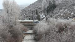 Cold Frosted stream facing highway semi-truck passes. Stock Footage