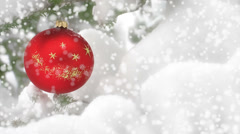 Winter Christmas snowy outdoor scene with red bubble Stock Footage