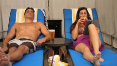 Couple relaxing on chairs vacation Stock Footage