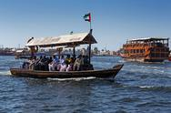 Stock Photo of traditional abra boat at the creek  in dubai, uae