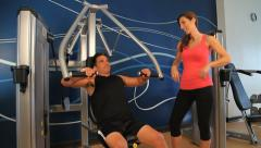Exercising in gym workout weightlifting Stock Footage