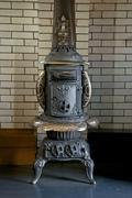 antique iron base burner stove - stock photo