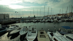 Pan shot of bouts in port - stock footage