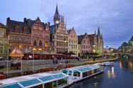 Stock Photo of buildings with tourboats, ghent