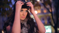 Beautiful woman in a fur and hat Stock Footage