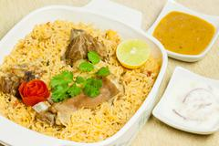 Mutton Biryani with Condiments - stock photo
