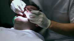 Dentist checking the quality of client's teeth and possible caries Stock Footage