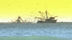 Commercial Fishing Boat on the Horizon in the Early Morning Stock Footage
