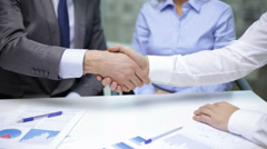two businessmen shaking their hands - stock footage