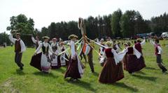 Happy people dance around horse figure in festival Run Horse Stock Footage