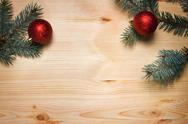 Stock Photo of christmas fir tree with decoration on a wooden board