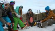 Stock Video Footage of Group of young people prepare to go snowboarding
