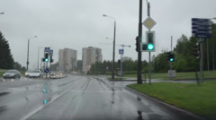 Cars go on urban city road and rain fall. Bad weather conditions Stock Footage