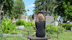 Young girl sit near soldier boyfriend grave. Lithuania flag Stock Footage