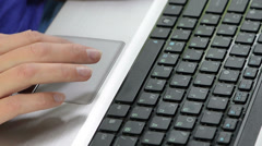 Woman hands typing text on laptop keyboard and touching touchpad Stock Footage