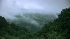 Fog covers the green hill Stock Footage
