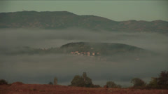 Morning fog reveals village in the Rhodope Mountains Stock Footage