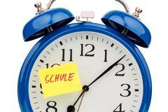 Alarm clock to the start of school Stock Photos