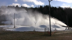 Making Early Season Snow on Ski Hill Stock Footage