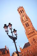 Stock Photo of belfry bell tower on sunset in bruges, belgium