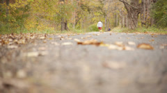 Man walking on trail in the Autumn Stock Footage