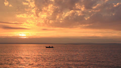 Spectacular Sea Sunset and a Rowing Boat 2 Stock Footage