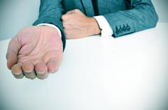 Man in suit with an outstretched hand Stock Photos