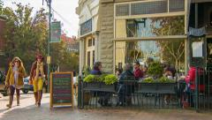 Posana Cafe Exterior with Walking People in Downtown Asheville, NC Stock Footage