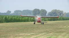 Light aircraft moving on field Stock Footage