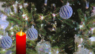 Stock Video Footage of Red candle with holiday ornaments and decorations