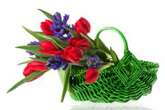 basket spring flowers - stock photo